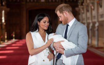 """File photo dated 08/05/19 of the Duke and Duchess of Sussex with their baby son Archie Harrison Mountbatten-Windsor, during a photocall in St George's Hall at Windsor Castle in Berkshire. The royal couple have announced they are to """"step back"""" as senior members of the royal family and will now divide their time between the UK and North America. (Dominic Lipinski / IPA/Fotogramma, Windsor - 2020-04-23) p.s. la foto e' utilizzabile nel rispetto del contesto in cui e' stata scattata, e senza intento diffamatorio del decoro delle persone rappresentate"""