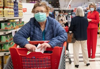 Queen Mathilde of Belgium (R) wearing a protective mask meets a customer as she visits the Carrefour supermarkets of Mestdagh groupe in Gerpinnes, on May 6, 2020 during a novel coronavirus (COVID-19) pandemic. (Photo by Benoit DOPPAGNE / BELGA / AFP) / Belgium OUT (Photo by BENOIT DOPPAGNE/BELGA/AFP via Getty Images)