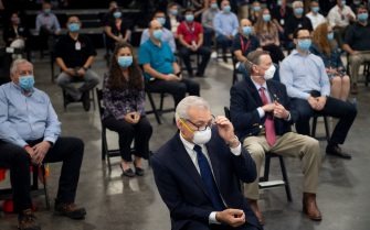 People wait for US President Donald Trump to speak at a Honeywell International Inc. factory during his first trip since widespread COVID-19 related lockdowns went into effect May 5, 2020, in Phoenix, Arizona. (Photo by Brendan Smialowski / AFP) (Photo by BRENDAN SMIALOWSKI/AFP via Getty Images)