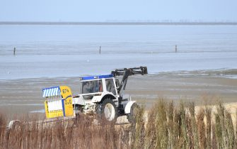 CUXHAVEN, GERMANY - MAY 06: A tractor moves beach chairs stand ready for vacationers at Duhne beach during the coronavirus crisis on May 6, 2020 near Cuxhaven, Germany. German states that contain popular holiday destinations and that are economically dependant on tourism, including Lower Saxony, Mecklenburg-Western Pomerania, Schleswig-Holstein and Bavaria, have announced an easing of lockdown measures in order to let hotels, restaurants and beaches reopen for visitors in coming weeks. (Photo by Stuart Franklin/Getty Images)