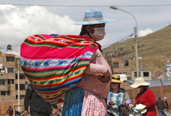 Indigenous women attend a street market in Puno, Peru, near the border with Bolivia, on May 1, 2020, despite the regulation to avoid crowded events to prevent the spread of the new coronavirus. - The government has identified markets as major hotspots of the COVID-19 virus. 40,459 cases of coronavirus and 1,124 casualties were confirmed in Peru so far. (Photo by Juan Carlos CISNEROS / AFP) (Photo by JUAN CARLOS CISNEROS/AFP via Getty Images)