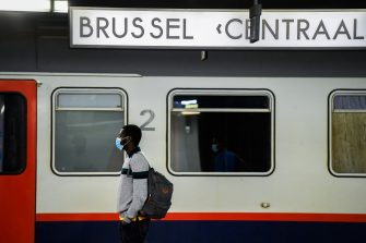 Illustration picture shows travellers wearing a mouth mask at SNCB NMBS Gare Centrale Bruxelles / Brussel Centraal Station, Monday 04 May 2020. From Today on wearing a mask that covers mouth and nose is mandatory to enter a train of public transport company SNCB - NMBS. Belgium is in its eighth week of confinement, but also the first day of the stage 1A of the deconfinement plan in the ongoing corona virus crisis. BELGA PHOTO LAURIE DIEFFEMBACQ (Photo by LAURIE DIEFFEMBACQ/BELGA MAG/AFP via Getty Images)