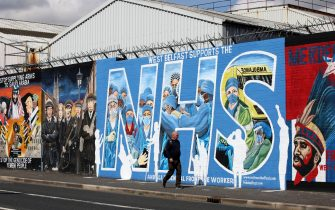 A street art graffiti mural in support of the NHS (National Health Service) is pictured on the Nationalist Falls road in west Belfast on May 5, 2020. - The number of people killed by the coronavirus in the UK stands at 32,313, according to official figures on May 5 2020, the second highest death toll in the world. Figures from the Office for National Statistics showed Britain had now overtaken Italy, which has reported 29,029 fatalities, and now only stands behind the US with 68,700 deaths, the largest single-country toll. (Photo by Paul Faith / AFP) (Photo by PAUL FAITH/AFP via Getty Images)