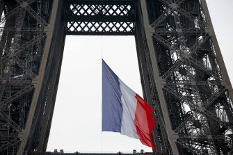 PARIS, FRANCE - MAY 08: A giant French flag flies in the middle of the Eiffel Tower to commemorate the 75th anniversary of the end of the Second World War on May 08, 2020 in Paris, France. On May 8th, 1945 the Allied Forces of World War II celebrated the formal acceptance of surrender of Nazi Germany. (Photo by Chesnot/Getty Images)