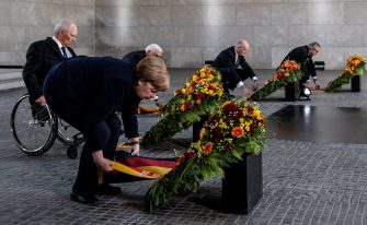 BERLIN, GERMANY - MAY 08: German Chancellor Angela Merkel, President of the German Parliament Bundestag Wolfgang Schaeuble, German President Frank-Walter Steinmeier, President of the Federal Council Bundesrat in Germany Dietmar Woidke and the presiding judge of the German Federal Constitutional Court's second senate, Andreas Vosskuhle attend wreath-laying ceremony to mark the 75th anniversary of the end of World War Two, at the Neue Wache Memorial on May 8, 2020 in Berlin, Germany. (Photo by Filip Singer - Pool/Getty Images)