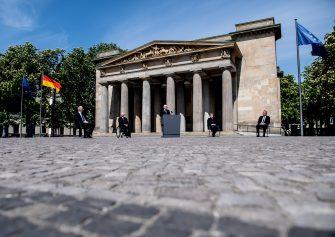 BERLIN, GERMANY - MAY 08: German Chancellor Angela Merkel (2nd-R), President of the German Parliament Bundestag Wolfgang Schaeuble (2nd -L), German President Frank-Walter Steinmeier (C), President of the Federal Council Bundesrat in Germany Dietmar Woidke (L)  and the presiding judge of the German Federal Constitutional Court's second senate, Andreas Vosskuhle (R) attend a ceremony to mark the 75th anniversary of the end of World War Two, at the Neue Wache Memorial on May 8, 2020 in Berlin, Germany. (Photo by Filip Singer - Pool/Getty Images)