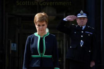 EDINBURGH, SCOTLAND - MAY 8: Scotland's First Minister Nicola Sturgeon pauses for a 2 minute silence to mark the 75th anniversary of VE Day (Victory in Europe Day), the end of the Second World War in Europe outside St Andrew's House on May 8, 2020 in Edinburgh, Scotland. The UK commemorates the 75th Anniversary of Victory in Europe Day (VE Day) with a pared-back rota of events due to the coronavirus lockdown. On May 8th, 1945 the Allied Forces of World War II celebrated the formal acceptance of surrender of Nazi Germany.  (Photo by Andy Buchanan/WPA Pool/Getty Images)