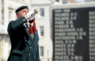 WEYMOUTH, ENGLAND - MAY 08: A bugler marks the 2 minutes silence on May 08, 2020 in Weymouth, United Kingdom. A VE Day wreath laying and silence is held at the War Memorial on the Esplanade in Weymouth. The UK commemorates the 75th Anniversary of Victory in Europe Day (VE Day) with a pared-back rota of events due to the coronavirus lockdown. On May 8th, 1945 the Allied Forces of World War II celebrated the formal acceptance of surrender of Nazi Germany. (Photo by Finnbarr Webster/Getty Images)