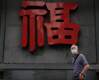 BEIJING, CHINA - MAY 08:  A Chinese man wears a protective mask as he looks on May 8, 2020 in Beijing, China. Life in Beijing is slowly returning to normal following a city-wide lockdown on January 25 to contain the coronavirus (COVID-19) outbreak. (Photo by Lintao Zhang/Getty Images)