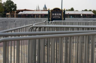 SHANGHAI, CHINA - MARCH 10: Fences set up by a closed gate of the main theme park of Shanghai Disneyland Park on March 10, 2020 in Shanghai, China. The Shanghai Disney Resort has said it will reopen some of the shopping, dining and entertainment options on Monday, though the main theme park will remain closed to prevent further spread of the coronavirus. Twenty-one of mainland China's 31 regions have lowered emergency response levels on the flu-like epidemic by March 1, allowing greater movement of people and goods and a recovery in business activity. Since the outbreak began in December last year, more than 80,000 cases have been confirmed in China, with the death toll rising to more than 3,100. As of today, the number of cases of new coronavirus COVID-19 being treated in China dropped to approximately 17,800 in China. The World Health Organization (WHO) declared to raises coronavirus threat assessment to â  very highâ   globally by the end of February. (Photo by Yifan Ding/Getty Images)