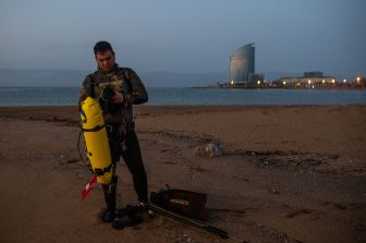 BARCELONA, SPAIN - MAY 08: Lucky gets ready for practicing spearfishing at dawn at La Barceloneta Beach opened for the first day since March 15 during the novel coronavirus crisis on May 08, 2020 in Barcelona, Spain. Permitted activities now include outdoor water sports such as surfing, paddle boarding or swimming from 6 - 10 AM and from 8 - 11 PM, with beaches only open for sporting activities such as running, working out or water sports. Spain has had more than 220,000 confirmed cases of COVID-19 and over 26,000 reported deaths, although the rate has declined after weeks of lockdown measures.  (Photo by David Ramos/Getty Images)