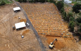 Aerial view of Nossa Senhora cemetery -where Brazilian Ulisses Xavier, 52, has worked for 16 years- in Manaus, Brazil, on May 7, 2020, amid the new coronavirus pandemic. - Xavier works 12 hours a day and supplements his income by making wooden crosses for graves. The cemetery has seen a surge in the number of new graves after the outbreak of COVID-19. (Photo by MICHAEL DANTAS / AFP) (Photo by MICHAEL DANTAS/AFP via Getty Images)