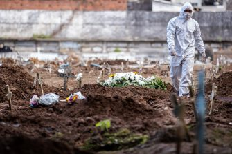 RIO DE JANEIRO, BRAZIL - MAY 08: An undertaker walks among open graves amidst the coronavirus (COVID-19) pandemic at the Caju cemetery on May 8, 2020 in Rio de Janeiro, Brazil.  According to the Brazilian Health Ministry, Brazil has 135.106 positive cases of coronavirus (COVID-19) and a total of 9.146  deaths. (Photo by Buda Mendes/Getty Images)
