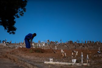 RIO DE JANEIRO, BRAZIL - MAY 08: An undertaker digs a grave amidst the coronavirus (COVID-19) pandemic at the Caju cemetery on May 8, 2020 in Rio de Janeiro, Brazil.  According to the Brazilian Health Ministry, Brazil has 135.106 positive cases of coronavirus (COVID-19) and a total of 9.146  deaths. (Photo by Buda Mendes/Getty Images)