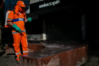 RIO DE JANEIRO, BRAZIL - MAY 08: Sanitary workers disinfect the streets during the partial lockdown in the Campo Grande neighborhood on May 08, 2020 in Rio de Janeiro, Brazil. Campo Grande is the neighborhood with the highest number of complaints of crowding during the quarantine and the second with the most deaths from coronavirus (COVID -19) in the city of Rio de Janeiro according to City Hall. According to the Brazilian Health Ministry, Brazil has 135,106 positive cases of coronavirus (COVID-19) and a total of 9,146 deaths. (Photo by Bruna Prado/Getty Images)