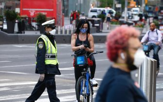 NEW YORK, NEW YORK - MAY 07: New Yorkers wearing protective masks are seen in Times Square as daily life continues amid the coronavirus outbreak on May 07, 2020 in New York City. COVID-19 has spread to most countries around the world, claiming over 270,000 lives and infecting over 3.9 million people.  (Photo by John Lamparski/Getty Images)