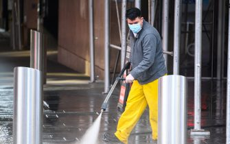 NEW YORK, NEW YORK - MAY 07: A person pressure washes the sidewalk in Times Square during the coronavirus pandemic on May 7, 2020 in New York City. COVID-19 has spread to most countries around the world, claiming over 270,000 lives with over 3.9 million infections reported. (Photo by Noam Galai/Getty Images)