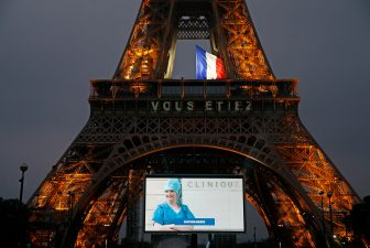 PARIS, FRANCE - MAY 10: A large screen in front of the Eiffel Tower displays photos of Parisians, caregivers and medical personnel to thank them for their dedication during the coronavirus pandemic on May 10, 2020 in Paris, France. The French government has drawn up a deconfinement plan that will take effect on May 11. The Coronavirus (COVID-19) pandemic has spread to many countries across the world, claiming over 280,000 lives and infecting over 4 million people. (Photo by Chesnot/Getty Images)