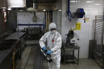 SEOUL, SOUTH KOREA - MAY 11: A disinfection professional wearing protective clothing spray anti-septic solution at cafeteria to prevent the spread of the coronavirus (COVID-19) ahead of school re-opening on May 11, 2020 in Seoul, South Korea. South Korea's education ministry announced plans to re-open schools starting from May 13, more than two months after schools were closed in a precautionary measure against the coronavirus. Coronavirus cases linked to clubs and bars in Seoul's multicultural district of Itaewon have jumped to 54, an official said Sunday, as South Korea struggles to stop the cluster infection from spreading further. According to the Korea Center for Disease Control and Prevention, 35 new cases were reported. The total number of infections in the nation tallies at 10,909. (Photo by Chung Sung-Jun/Getty Images)