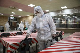 SEOUL, SOUTH KOREA - MAY 11: Disinfection professionals wearing protective clothing spray anti-septic solution at cafeteria to prevent the spread of the coronavirus (COVID-19) ahead of school re-opening on May 11, 2020 in Seoul, South Korea. South Korea's education ministry announced plans to re-open schools starting from May 13, more than two months after schools were closed in a precautionary measure against the coronavirus. Coronavirus cases linked to clubs and bars in Seoul's multicultural district of Itaewon have jumped to 54, an official said Sunday, as South Korea struggles to stop the cluster infection from spreading further. According to the Korea Center for Disease Control and Prevention, 35 new cases were reported. The total number of infections in the nation tallies at 10,909. (Photo by Chung Sung-Jun/Getty Images)