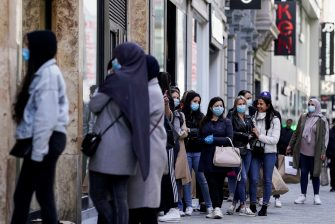 People queue to enter a clothing store on its reopening day, on May 11, 2020 in Brussels, as the lockdown introduced two months ago to fight the spread of the Covid-19 disease caused by the novel coronavirus starts to ease. (Photo by Kenzo TRIBOUILLARD / AFP) (Photo by KENZO TRIBOUILLARD/AFP via Getty Images)