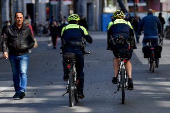 Illustration picture shows two police officers on bikes in the Meir shopping street in the city center of Antwerp, Monday 11 May 2020. Belgium goes into its ninth week of confinement. Stage 1B of the deconfinement plan in the ongoing corona virus crisis starts. All shops can reopen and more people can return to work. BELGA PHOTO DIRK WAEM (Photo by DIRK WAEM/BELGA MAG/AFP via Getty Images)