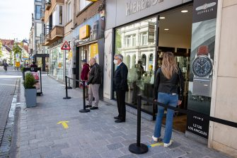 Illustration picture shows people queuing in the shopping street, during a visit of Minister Muylle to clothes shops Boggie and Brooklyn, in the city center of Roeselare, Monday 11 May 2020. Belgium goes into its ninth week of confinement. Stage 1B of the deconfinement plan in the ongoing corona virus crisis starts. All shops can reopen and more people can return to work. BELGA PHOTO KURT DESPLENTER (Photo by KURT DESPLENTER/BELGA MAG/AFP via Getty Images)