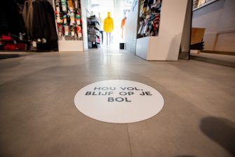 Illustration picture shows Covid 19 measures illustrated with floor stickers saying 'Hou vol, Blijf op je bol' (Hold on, stay on your circle) to indicate waiting spots, during a visit of Minister Muylle to clothes shops Boggie and Brooklyn, in the city center of Roeselare, Monday 11 May 2020. Belgium goes into its ninth week of confinement. Stage 1B of the deconfinement plan in the ongoing corona virus crisis starts. All shops can reopen and more people can return to work. BELGA PHOTO KURT DESPLENTER (Photo by KURT DESPLENTER/BELGA MAG/AFP via Getty Images)