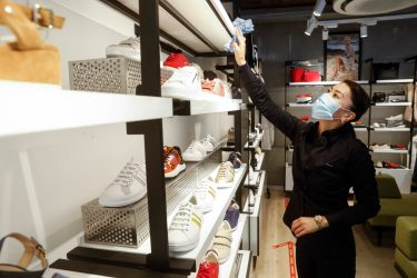 Illustration picture shows an employee of a shoes shop at the Avenue Louise shopping neighbourhood in Brussels, Monday 11 May 2020. Belgium goes into its ninth week of confinement. Stage 1B of the deconfinement plan in the ongoing corona virus crisis starts. All shops can reopen and more people can return to work. BELGA PHOTO THIERRY ROGE (Photo by THIERRY ROGE/BELGA MAG/AFP via Getty Images)