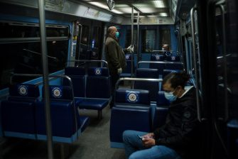 epa08413892 Commuters wearing face masks keep social distance as they ride a subway metro wagon in Paris, France, 11 May 2020. France began a gradual easing of its lockdown measures and restrictions amid the COVID-19 pandemic.  EPA/JULIEN DE ROSA