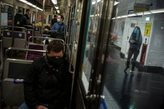 epa08413889 Commuters wearing face masks keep social distance as they ride a subway metro wagon in Paris, France, 11 May 2020. France began a gradual easing of its lockdown measures and restrictions amid the COVID-19 pandemic.  EPA/JULIEN DE ROSA