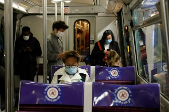 Commuters wearing face masks are seen in a metro train, on May 11, 2020 in Paris, as the lockdown introduced two months ago to fight the spread of the Covid-19 disease caused by the novel coronavirus starts to ease. (Photo by GEOFFROY VAN DER HASSELT / AFP) (Photo by GEOFFROY VAN DER HASSELT/AFP via Getty Images)