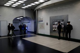 Policemen control commuters at a metro station in Paris, on May 11, 2020, as the lockdown introduced two months ago to fight the spread of the Covid-19 disease caused by the novel coronavirus starts to ease. (Photo by THOMAS COEX / AFP) (Photo by THOMAS COEX/AFP via Getty Images)
