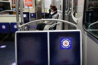 Commuters wearing face mask sit in a metro train in Paris, on May 11, 2020, as the lockdown introduced two months ago to fight the spread of the Covid-19 disease caused by the novel coronavirus starts to ease. (Photo by THOMAS COEX / AFP) (Photo by THOMAS COEX/AFP via Getty Images)