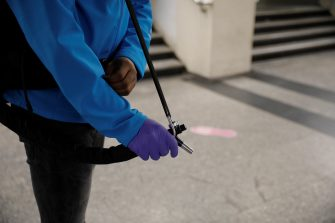 RATP employees carry a load of hydroalcoholic gel in order to disinfect commuters' hands as they arrive at a metro station, on May 11, 2020 in Paris, as the lockdown introduced two months ago to fight the spread of the Covid-19 disease caused by the novel coronavirus starts to ease. (Photo by GEOFFROY VAN DER HASSELT / AFP) (Photo by GEOFFROY VAN DER HASSELT/AFP via Getty Images)