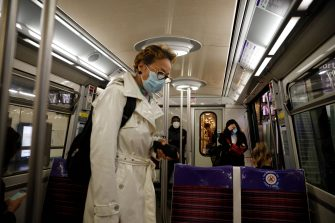 Commuters wearing face masks are seen at a metro station, on May 11, 2020 in Paris, as the lockdown introduced two months ago to fight the spread of the Covid-19 disease caused by the novel coronavirus starts to ease. (Photo by GEOFFROY VAN DER HASSELT / AFP) (Photo by GEOFFROY VAN DER HASSELT/AFP via Getty Images)