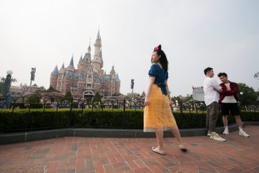 SHANGHAI, CHINA - MAY 11: Tourists visit Shanghai Disneyland after its reopening on May 11, 2020 in Shanghai, China. Shanghai Disneyland has reopened its gates following months of shutdown, offering a potential model for other mass entertainment venues around the world to open for business during the pandemic. (Photo by Hu Chengwei/Getty Images)