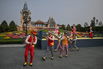 Musicians perform during the reopening of the Disneyland amusement park in Shanghai on May 11, 2020. - Disneyland Shanghai reopened on May 11 to the public after being closed since January due to the COVID-19 coronavirus outbreak. (Photo by Hector RETAMAL / AFP) (Photo by HECTOR RETAMAL/AFP via Getty Images)