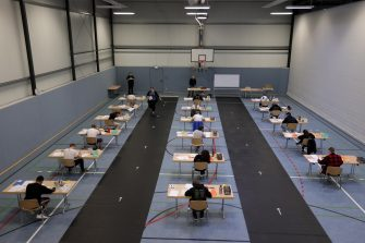 epa08416458 Students write their final examination paper on biology, in a sports hall, which has been converted into a classroom in accordance with the latest German health regulations, at the Privat High School Stadtkrone (PGS) in Dortmund, Germany, 12 May 2020. Due to the ongoing coronavirus pandemic, the final secondary-school examinations in the German state of North Rhine-Westphalia are starting with strict safety precautions.  EPA/FRIEDEMANN VOGEL