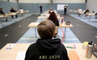 epa08416462 Students write their final examination paper on biology, in a sports hall, which has been converted into a classroom in accordance with the latest German health regulations, at the Privat High School Stadtkrone (PGS) in Dortmund, Germany, 12 May 2020. Due to the ongoing coronavirus pandemic, the final secondary-school examinations in the German state of North Rhine-Westphalia are starting with strict safety precautions.  EPA/FRIEDEMANN VOGEL