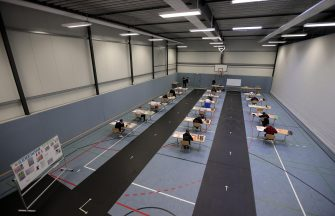 epa08416459 Students write their final examination paper on biology, in a sports hall, which has been converted into a classroom in accordance with the latest German health regulations, at the Privat High School Stadtkrone (PGS) in Dortmund, Germany, 12 May 2020. Due to the ongoing coronavirus pandemic, the final secondary-school examinations in the German state of North Rhine-Westphalia are starting with strict safety precautions.  EPA/FRIEDEMANN VOGEL