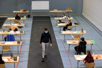 epa08416475 Students prepare for their final examination paper on biology, in a sports hall, which has been converted into a classroom in accordance with the latest German health regulations, at the Privat High School Stadtkrone (PGS) in Dortmund, Germany, 12 May 2020. Due to the ongoing coronavirus pandemic, the final secondary-school examinations in the German state of North Rhine-Westphalia are starting with strict safety precautions.  EPA/FRIEDEMANN VOGEL