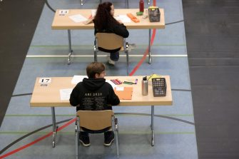 epa08416473 Students prepare for their final examination paper on biology, in a sports hall, which has been converted into a classroom in accordance with the latest German health regulations, at the Privat High School Stadtkrone (PGS) in Dortmund, Germany, 12 May 2020. Due to the ongoing coronavirus pandemic, the final secondary-school examinations in the German state of North Rhine-Westphalia are starting with strict safety precautions.  EPA/FRIEDEMANN VOGEL