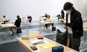epa08416470 Students arrive for their final examination paper on biology, in a sports hall, which has been converted into a classroom in accordance with the latest German health regulations, at the Privat High School Stadtkrone (PGS) in Dortmund, Germany, 12 May 2020. Due to the ongoing coronavirus pandemic, the final secondary-school examinations in the German state of North Rhine-Westphalia are starting with strict safety precautions.  EPA/FRIEDEMANN VOGEL