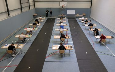 epa08416460 Students write their final examination paper on biology, in a sports hall, which has been converted into a classroom in accordance with the latest German health regulations, at the Privat High School Stadtkrone (PGS) in Dortmund, Germany, 12 May 2020. Due to the ongoing coronavirus pandemic, the final secondary-school examinations in the German state of North Rhine-Westphalia are starting with strict safety precautions.  EPA/FRIEDEMANN VOGEL
