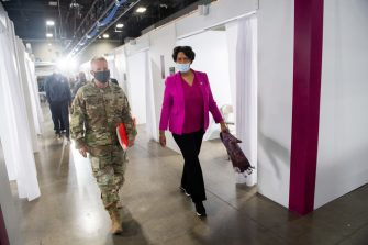 Mayor Muriel Bowser (R) of Washington, DC, walks alongside Lt. General Todd T. Semonite, Chief of Engineers and Commanding General of the US Army Corps of Engineers, at a temporary field hospital that he helped construct at the Walter E. Convention Center in Washington, DC on May 11, 2020, featuring 437 beds for patients suffering from coronavirus, COVID-19, and part of the city's medical surge response plan as an alternate care site to assist hospitals. (Photo by SAUL LOEB / AFP) (Photo by SAUL LOEB/AFP via Getty Images)