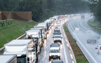 epa08418767 (FILE) - Trucks queue on the A93 motorway in the direction of Austria near Oberaudorf, Bavaria, Germany, 29 July 2019 (reissued 13 May 2020). Media reports state on 13 May 2020 that Germany is planning to partially ease border controls as early as 16 May 2020, following a decision of the Cabinet. At the same time, Austria is planning to reopen the border with Germany as early as 15 June, media added.  EPA/LUKAS BARTH-TUTTAS *** Local Caption *** 55368939
