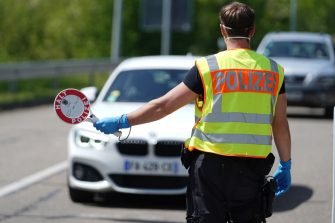 RASTATT, GERMANY - MAY 08: A German border police officer stops cars in a checkpoint of the D87 road at the German-French border during the coronavirus crisis on May 8, 2020 near Rastatt, Germany. The rates of new infections in both Germany and France, as in much of the European Union, have fallen dramatically over recent weeks, allowing governments to ease lockdown measures and strengthening demands by both business leaders and local communities to reopen international borders. In Germany so far Interior Minister Horst Seehofer is resisting a fast-paced lifting of border closures. (Photo by Thomas Niedermueller/Getty Images)