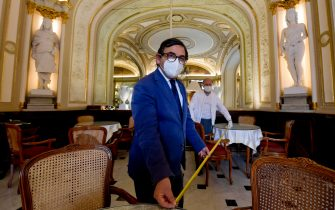 A moment of preparations for the reopening of Cafè 'Gambrinus'in Naples during phase two of the coronavirus emergency, Italy, 14 May 2020. Several countries around the world have started to ease COVID-19 lockdown restrictions in an effort to restart their economies and help people in their daily routines after the outbreak of coronavirus pandemic. ANSA/CIRO FUSCO