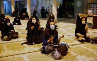 epa08418184 Iranian women wearing face masks pray during a religious ceremony called Laylat Al Qadr during the holy fasting month of Ramadan, in a mosque at the Tehran's university, in Tehran, Iran, 12 May 2020, as Iranian government reopened some mosques temporary for three nights as all mosques were closed following coronavirus crises in the country. Iranian Muslims spent the night in prayer until early in the morning commemorating Laylat Al Qadr (The Night of Power), which is the anniversary of the night that Muslims believe Prophet Muhammad received the first revelation of the Koran by the angel Gabriel. It is also said that is one of the odd nights of the last ten days of holy month of Ramadan and is better than 1,000 months of worship. Muslims believe that on this night until next morning, the blessings and mercy of Allah is abundant, sins are forgiven, supplications are accepted, and that the annual decree is revealed to the angels who also descend to earth.  EPA/ABEDIN TAHERKENAREH